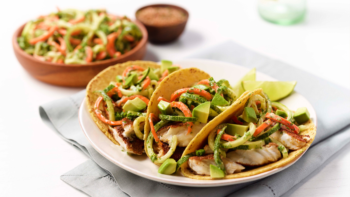 jerk tilapia fish tacos with zoodle or zucchini noodle slaw