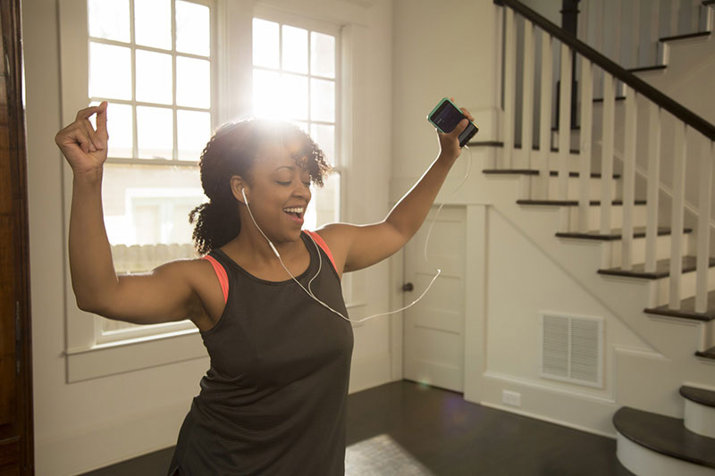 Woman exercising while listening to music