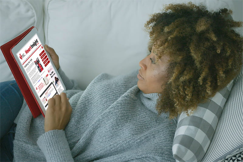 Woman reading Heart Insight on tablet