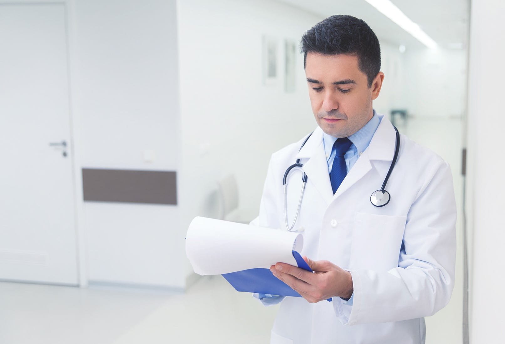 doctor writing to clipboard